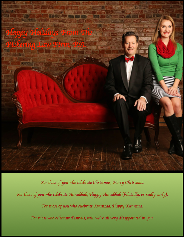 Chris and Margot Pickering of the Pickering Law Firm posing for a Holiday card.